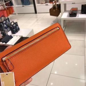 1d6b2b572bd15a ... cheap michael kors bags mk leather slim wallet orange ec2a5 14d05